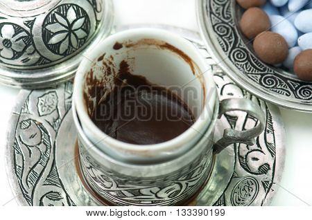 Fortunetelling with turkish coffee Empty cup after turkish coffee - concept of traditional way of furtunetelling.