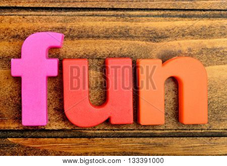 Colorful letters Fun word on wooden table