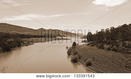 Shore of a Mountain Lake Covered with Forests in Sicily Vintage Style Sepia