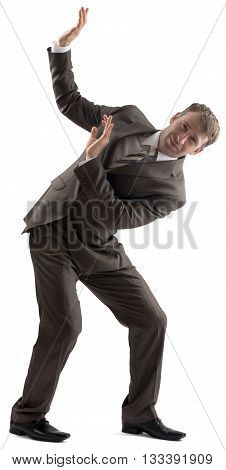 Embarrassed caucasian businessman in business formal outfit defending with body isolated on white background
