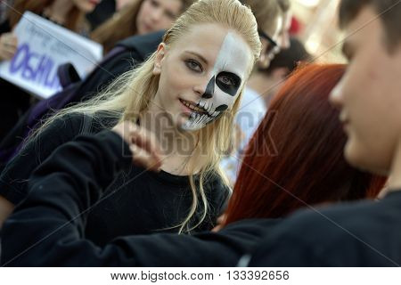 NOVOSIBIRSK RUSSIA - JUNE 4 2016: Female student in stage costume takes part in the youth festival