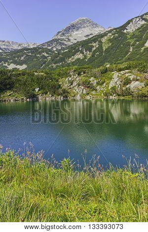 Amazing panorama of Muratov peak and Okoto lake, Pirin Mountain, Bulgaria