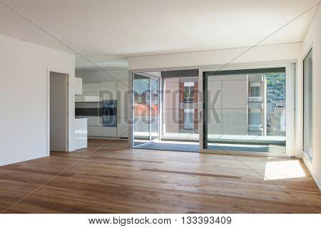 Interior of empty apartment, room with balcony, sliding door