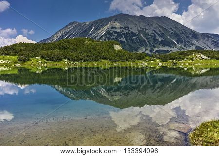 Reflection of Todorka peak in Muratovo lake, Pirin Mountain, Bulgaria