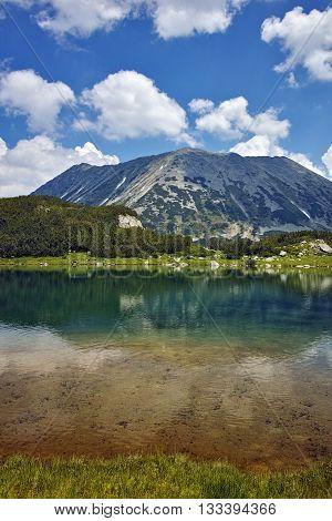 Amazing landscape with Reflection of Todorka peak in Muratovo lake, Pirin Mountain, Bulgaria