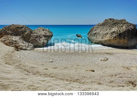 Big Rock in the blue waters of Megali Petra Beach, Lefkada, Ionian Islands, Greece