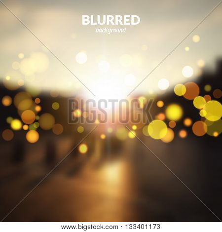 Blurred city street landscape with bokeh lights effect. Sunrise.