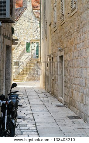 Narrow alley and stairs in Jelsa Hvar Croatia