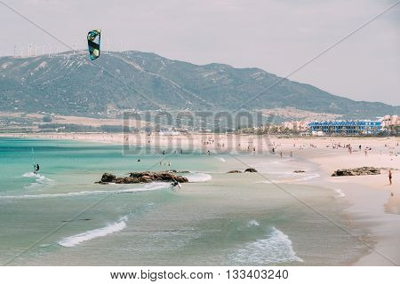Tarifa Spain - June 21 2015: Kite surfing in Tarifa Spain. Tarifa is most popular places in Spain for kitesurfing.