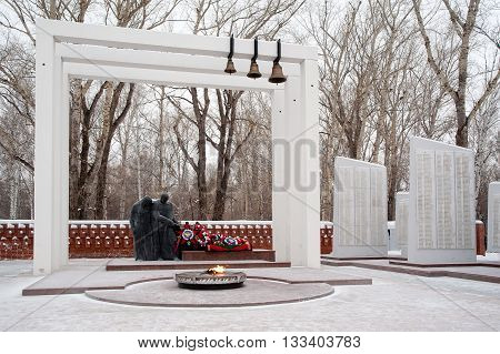 Tyumen, Russia - January 10, 2011: World War II Memorial on Memory Square. Sculpture with eternal flame