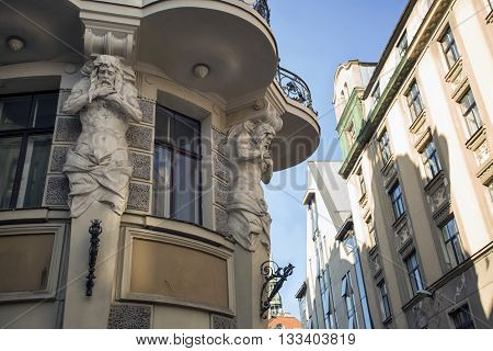 Architectural fragment of a sculptural bas-relief on the small street of the old city. Europe. Riga.