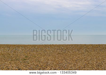 A view of the sea horizon line from the pebble beach of Hastings in England.