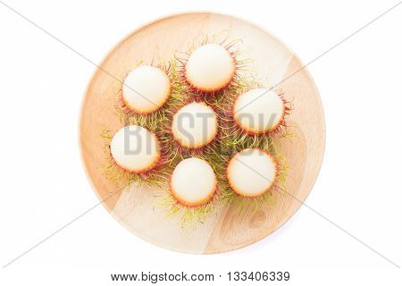 rambutan in the wooden disk on white background