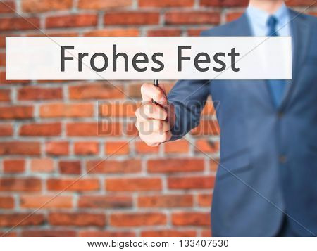 Frohes Fest (happy Christmas In German) - Businessman Hand Holding Sign