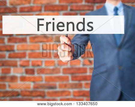 Friends - Businessman Hand Holding Sign