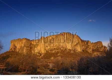 Bismantova stone castelnuovo monti at sunset in autumn
