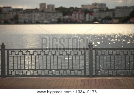 fence in the background of the lake.