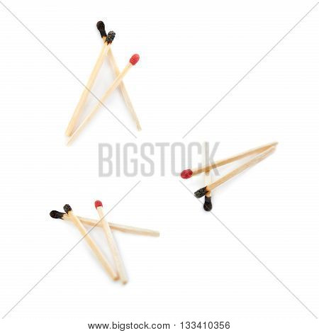 Set of Pile of Wooden used burnt and one unused matches isolated over the white background, as chosen one concept