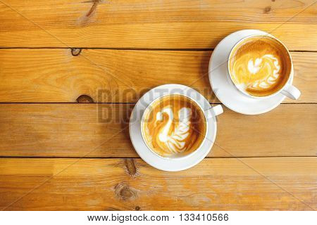 two cups of cappuccino image with a pattern on the Skin