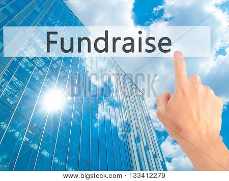 Fundraise - Hand Pressing A Button On Blurred Background Concept On Visual Screen.