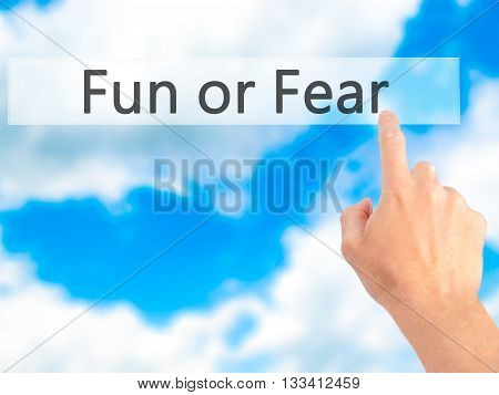 Fun Or Fear - Hand Pressing A Button On Blurred Background Concept On Visual Screen.