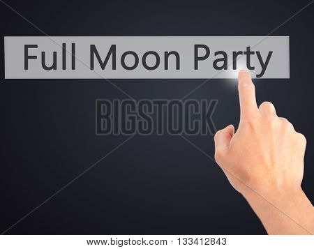 Full Moon Party - Hand Pressing A Button On Blurred Background Concept On Visual Screen.