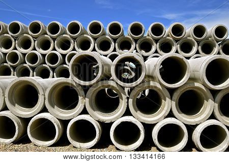 Piles of concrete tubes for industrial engineering projects form a vast collage of circles.
