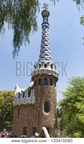 BARCELONA SPAIN - JULY 12 2013: Architectural masterpieces of Antoni Gaudi in Guell park attract many tourists