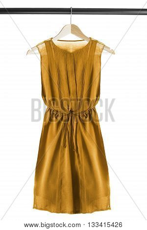 Yellow chiffon dress on wooden clothes rack isolated over white