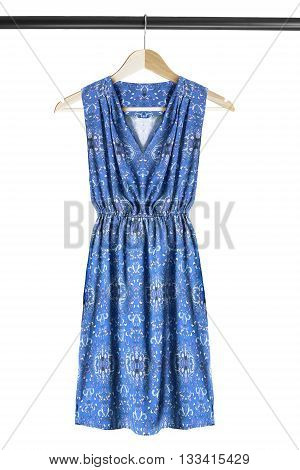 Blue dress on wooden clothes rack isolated over white