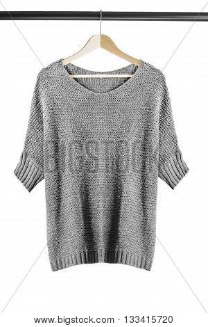 Gray sweater on wooden clothes rack isolated over white