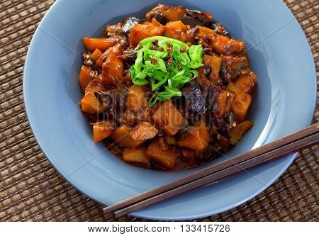 Asian vegetarian meal with potatoes and eggplants. Close up