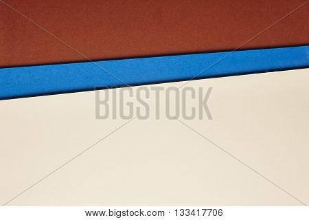 Colored cardboards background in brown blue beige tone. Copy space. Horizontal