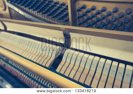 Close up of Inside the piano with selective focus Close up of Inside the piano ,Filtered image processed vintage effect.