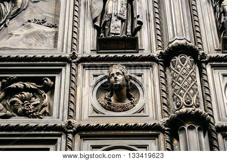 Detail of the gate of St. Isaac's Cathedral in St. Petersburg. Regal head of a young girl.