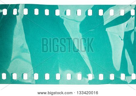Blank crumpled noisy cyan filmstrip isolated on white background