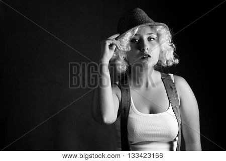Beautiful woman in hat, business style. Blonde girl, attractive woman with beautiful eyes. Handsome woman with sensual lips in gangster style. Sexy young woman with curly hair.