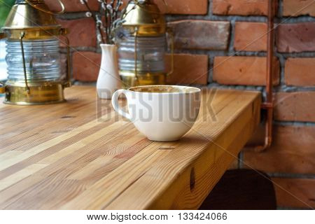 picture white cup on a wooden table