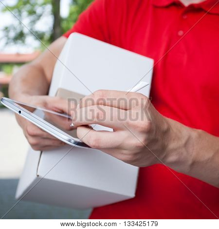 Courier Using Tablet At Work