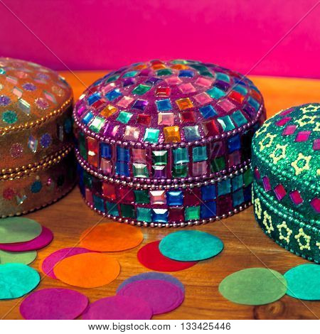 indian colorful box on pink table .