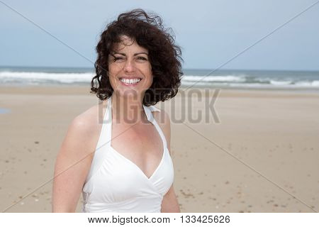 Portrait of a smiling 40-year-old brunette woman