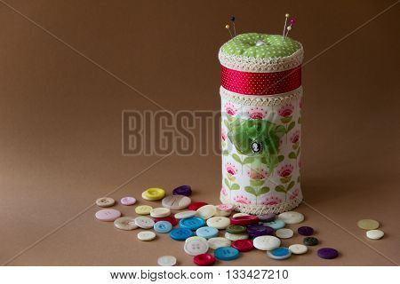 box with a pillow for needles and buttons. needlework. sewing