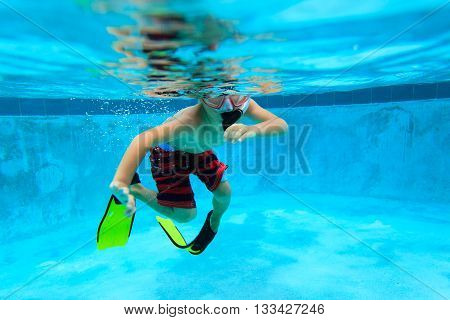 little boy swimming underwater with mask and flippers, active kids