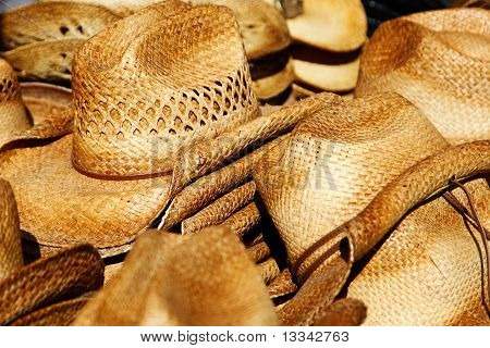 Piles of straw cowboy hats