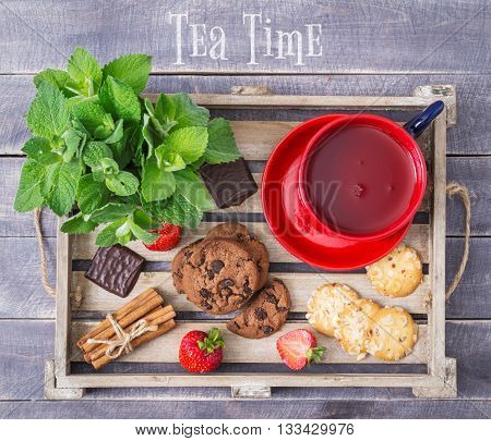 Tea Time. Sweet Menu. Top View. Tea Berries and Cookies on Wooden Tray. Rustic Cover Menu.