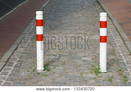 bollards on traffic-calmed city street blocking road for car traffic