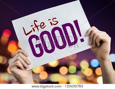 Life is Good placard with night lights on background
