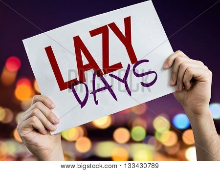 Lazy Days placard with night lights on background