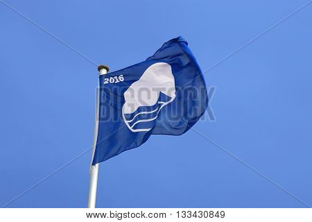 Rostock, Germany - May 30th, 2016: Warnemunde beach was awarded the Blue Flag certification by the Foundation for Environmental Education, FEE, for meeting its environmental and water quality standards.