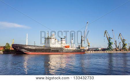 Mudyug. Port Icebreaker Moored In Port